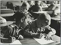 Boys Writing at School